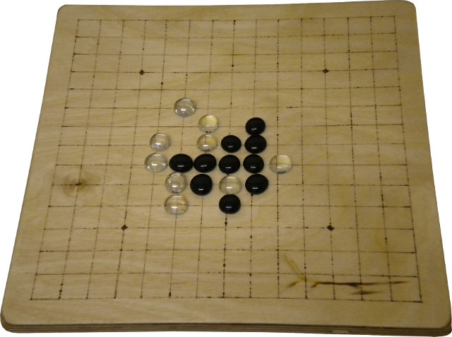 A home-made renju board with glass pieces.