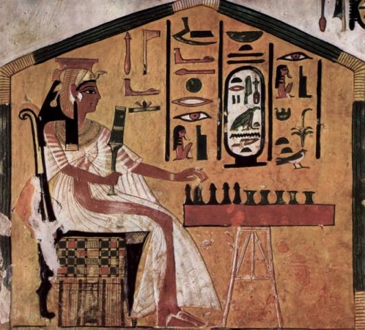 Queen Nefertari playing senet in a tomb painting.